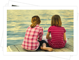 Young girls fishing on a pier